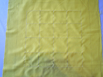 縫いつける印