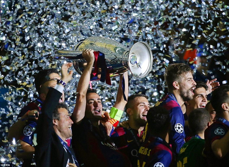 Xavi hoists the European Cup