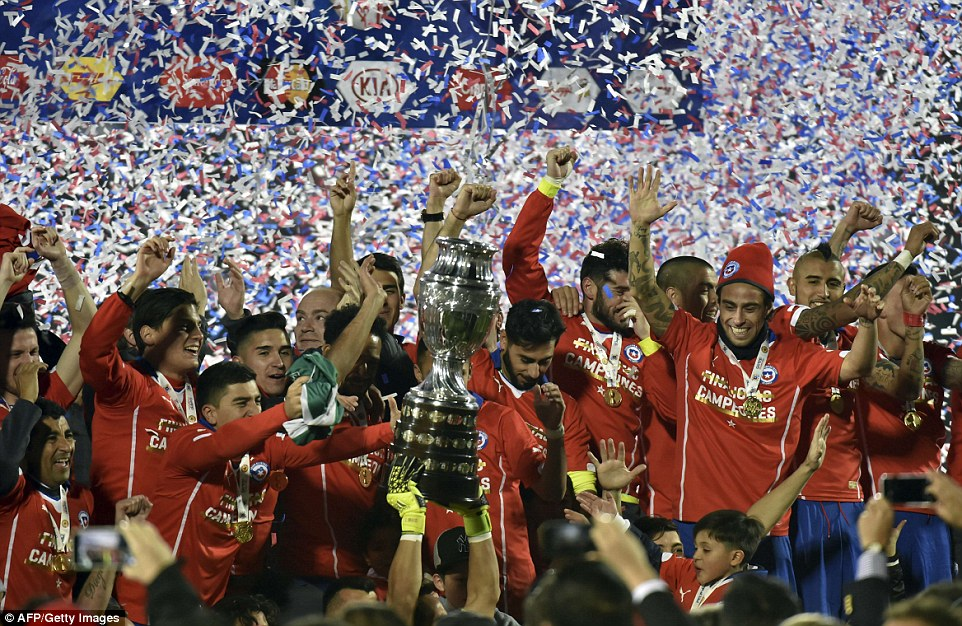 Chile squad celebrate with the Copa America trophy