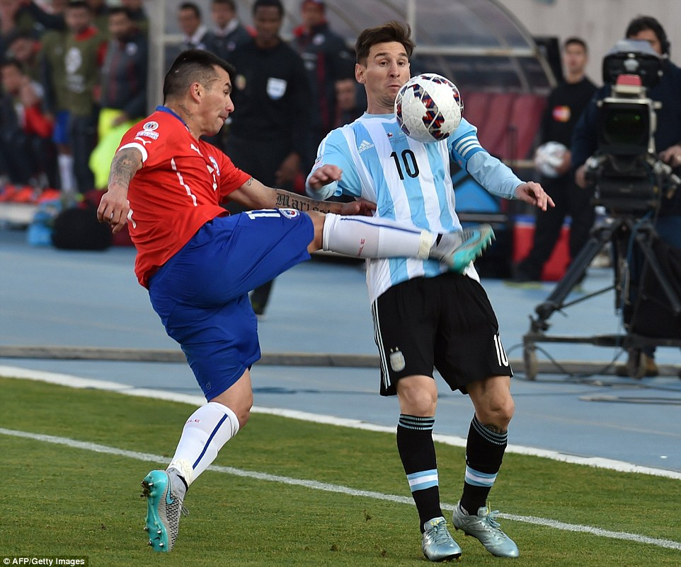 Messi gets a kick in the midriff by Gary Medel