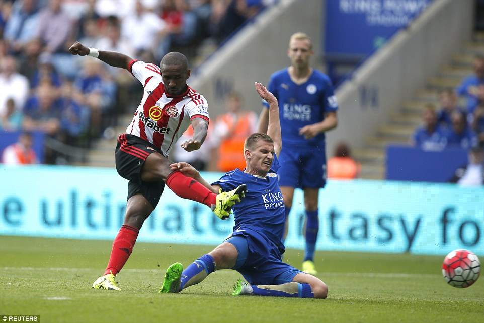 Defoe pulls one back for his side by striking the ball past Leicester