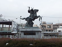 220px-Statue_of_Nitta_Yoshisada_at_Bubaigawara_Station.jpg