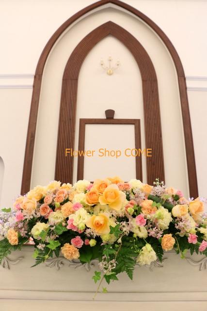 ピンク 黄色 結婚式 花