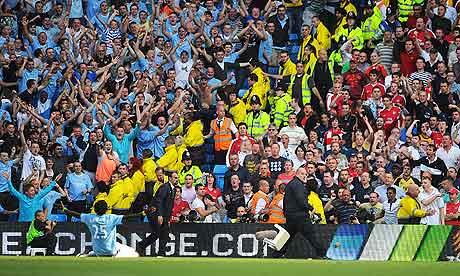 Adebayor celebrates scoring in front of the Arsenal fans